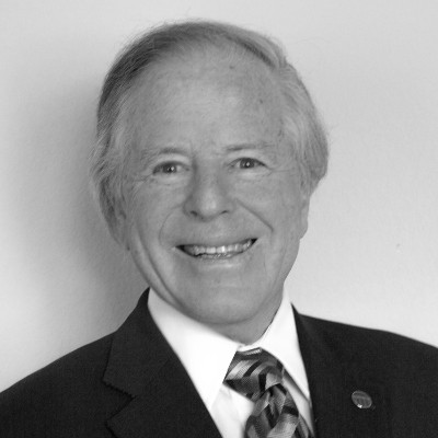 Charles R. Trimble, Chairman of the Board